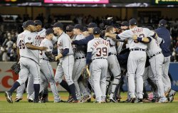Detroit Tigers closer Jose Valverde (46), Don Kelly (32), Ramon Santiago, Joaquin Benoit react at the end of game 5 of the ALDS at Yankee Stadium in New York