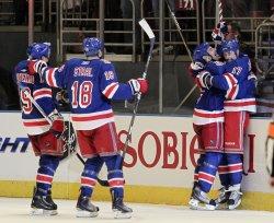 New York Rangers Brandon Dubinsky hugs Sean Avery at Madison Square Garden in New York
