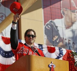 Los Angeles Angels' pitcher C.J Wilson is introduced to the media during a news conference in Anaheim, California