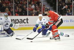 Blackhawks Hossa tries to score against Canucks in Chicago