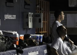 New York Yankees Jorge Posada and Mark Teixeira at the end of game 5 of the ALDS at Yankee Stadium in New York
