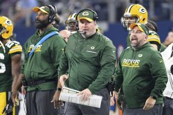Green Bay Packers head coach Mike McCarthy thinks about throwing a challenge flag