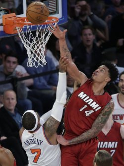 Heat Gerald Green blocks a shot by Knicks Carmelo Anthony