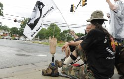 Protestors gather at Fort Meade, Maryland as PFC Manning court martial begins