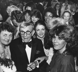 George Burns surrounded by women after a performance in Atlantic City