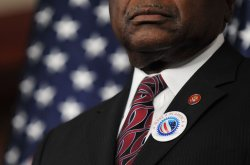 "James Clyburn wears a ""Make it in America"" button at a press conference in Washington"