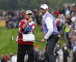Cink celebrates his putt on the second day of Ryder Cup.