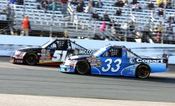 Kyle Busch passes Ron Hornaday in the NASCAR truck race in Loudon, New Hampshire