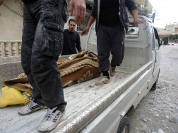 Syrians Inspect the damage to their homes