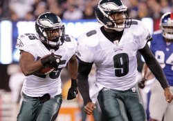 Philadelphia Eagles Vince Young looks to make a block for running back LeSean McCoy at MetLife Stadium in New Jersey