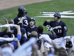 Brewers Braun and Hairston celebrate home run during NLCS in Milwaukee, Wisconsin