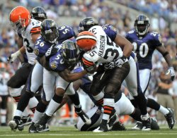 Cleveland Browns' running back Jerome Harrison is stopped by the Baltimore Ravens defense in Baltimore