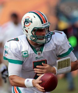Dolphins Chad Henne passes in Miami.
