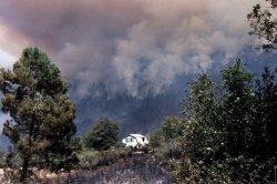 Western Fires Rage