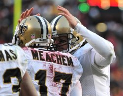 New Orleans Saints' Robert Meachem is congratulated by Drew Brees in Landover, Maryland