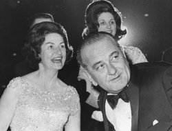 President and Mrs. Lyndon Johnson and their daughter Lynda Bird enjoy entertainment at the Presidential Gala at the DC National Guard Armory