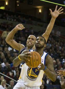 Warriors Dorell Wright pursued by San Antonio Spurs Richard Jefferson in Oakland, California