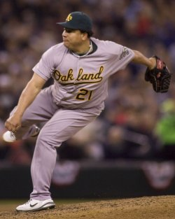 Oakland Athletics starter Bartolo Colon holds the Seattle Mariners to four hits in win in Seattle.