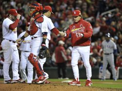 Cardinals pitcher Fernando Salas is taken out during game 2 of the World Series in St. Louis
