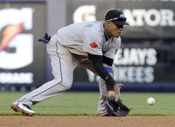 Toronto Blue Jays Yunel Escobar fields a ball at Yankee Stadium in New York