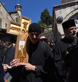 An Orthodox Priest Carries A Cross On Good Friday, Jerusalem