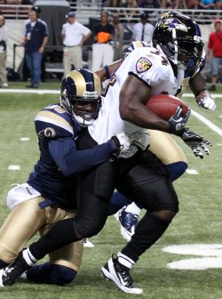 Ravens Ricky Williams is tackled in St.Louis