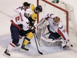 Capitals Holtby stops Bruins shot at TD Garden in Boston, MA.