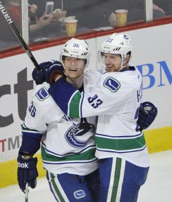 Canucks Hansen and Sedin celebrate goal in Chicago