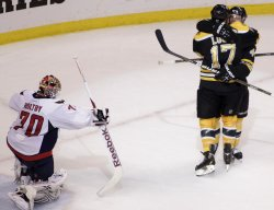 Bruins Seidenberg scores against Capitals Holtby at TD Garden in Boston, MA.