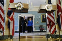 Sec. Clinton and British Foreign Secretary Miliband arrive at press conference in Washington