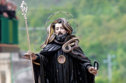 A statue of Saint Domenico surrounded by live snakes in Cocullo, Italy