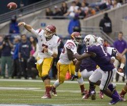 USC Trojans quarterback Matt Barkley passes against the Washington Huskies defense at CenturyLink Field in Seattle.