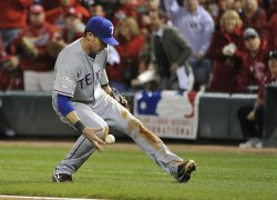 Rangers Michael Young goes after a wild throw during game 6 of the World Series in St. Louis