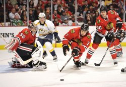 Blackhawks Seabrook Reaches for Puck against Predators in Chicago