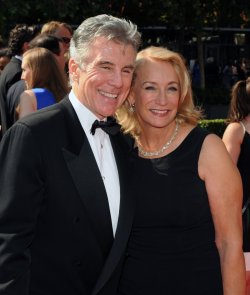 John Walsh (L) and wife Reve Drew arrive at the Primetime Creative Arts Emmy Awards in Los Angeles