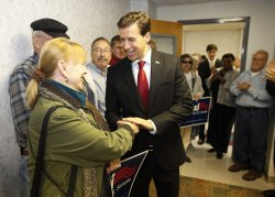 Giannoulias shakes hands with supporters in Peoria, Illinois