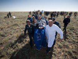 Soyuz TMA-17 capsule lands in Kazakhstan