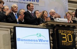 Berkshire Hathaway Chairman Warren E. Buffett and Business Wire CEO Cathy Baron Tamraz at the NYSE on Wall Street in New York
