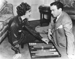Gracie Allen and husband George Burns play backgammon together