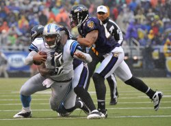 Lions' quarterback Daunte Culpepper is tackled in Baltimore