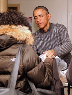 President Obama gives food to the needy in Washington