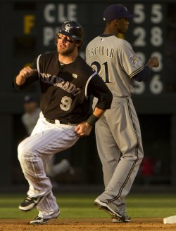 Rockies Stewart Races Past Brewers Escobar in Denver