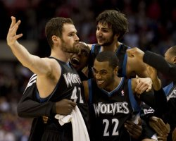 Minnesota Timberwolves Kevin Love (L) celebrates with teammates Wayne Ellington(22) and Ricky Rubio after beating the Los Angeles Clippers
