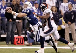 Colts Clark Grabs Pass in Front of Broncos Dawkins