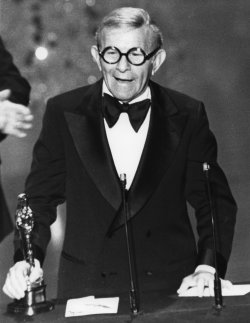 George Burns receives Oscar for best supporting actor in The Sunshine Boys