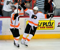 Philadelphia Flyers' Darroll Powe celebrates after scoring in Washington
