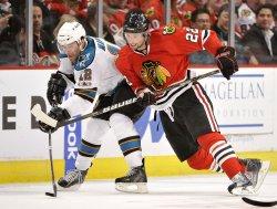 Blackhawks Brouwer checks Sharks Marleau in Chicago