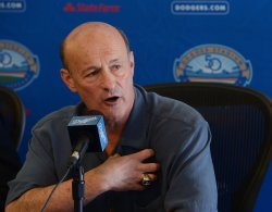 Stan Kasten participates in a news conference to announce Dodgers blockbuster trade in Los Angeles
