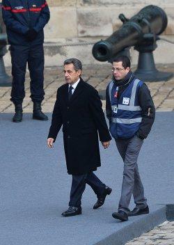 Sarkozy arrives at ceremony honoring victims of recent terrorist attacks in Paris