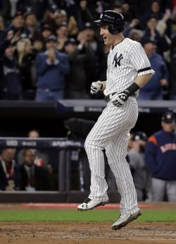 Yankees Frazier celebrates 3-run homer against Astros in the ALCS